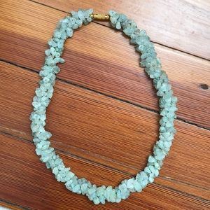 Jewelry - Necklace with green and hints of purple.